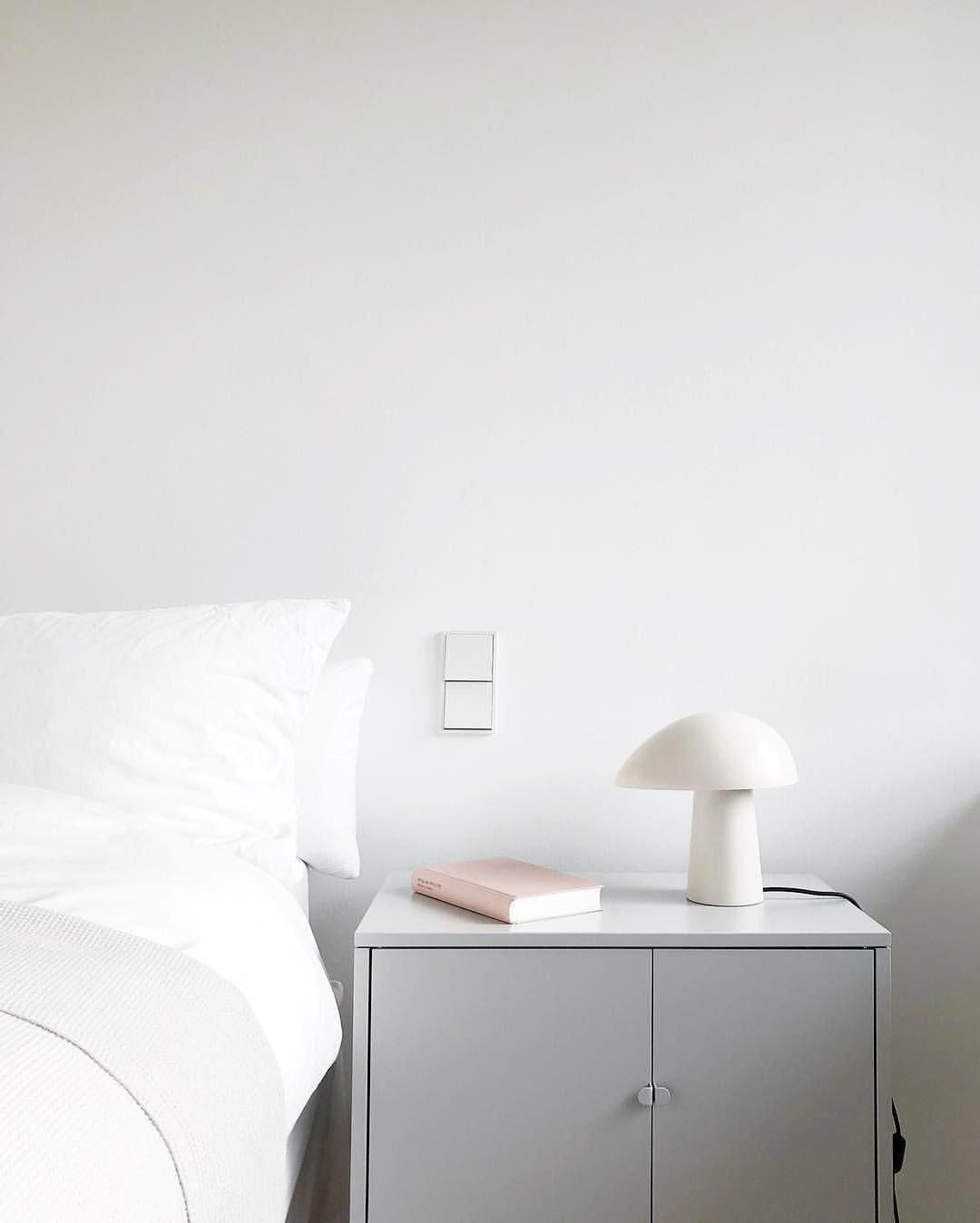 White tablet lamp and Ikea bedside cabinet, some small framed art ...