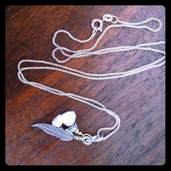 "Pomo 18"" Sterling 925 Silver Feather Necklace Pomo 925 pure Silver gold finish detail with Sterling Silver one inch feather and pearl Keshi with a Brazilian silver star and real aqua marine stone . Slender and sleek diver necklace and pendent . Exceptionally hot with a low cut blouse , also works great as a layer piece for other multi chain necklaces worn at different lengths Azura Pacific  Accessories"
