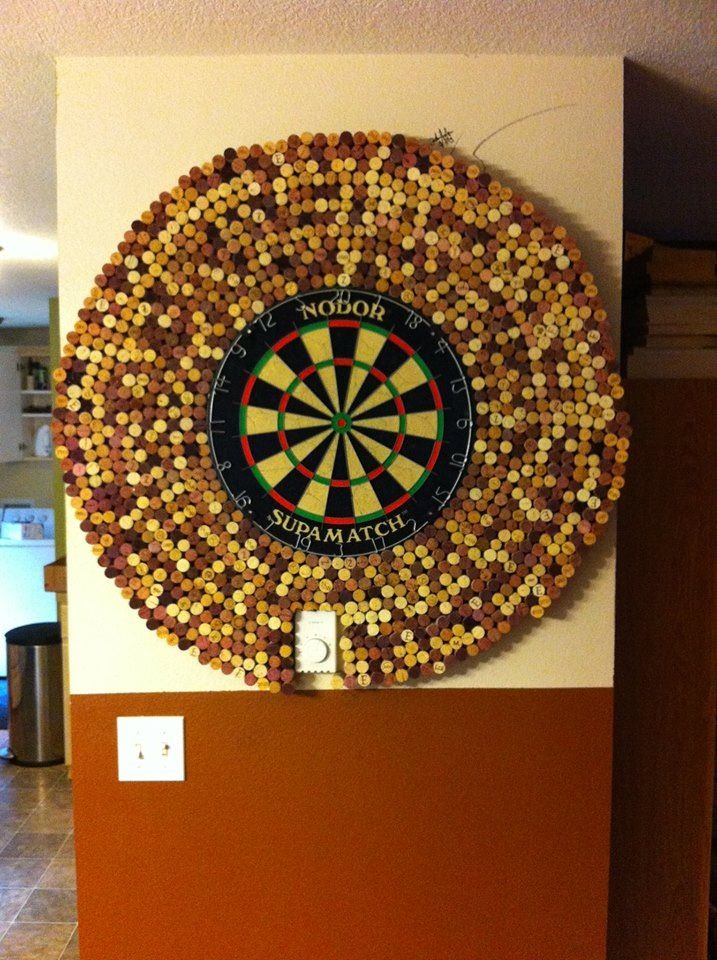 add wine corks around a dart board to protect your walls hot glue first row to the board itself. Black Bedroom Furniture Sets. Home Design Ideas