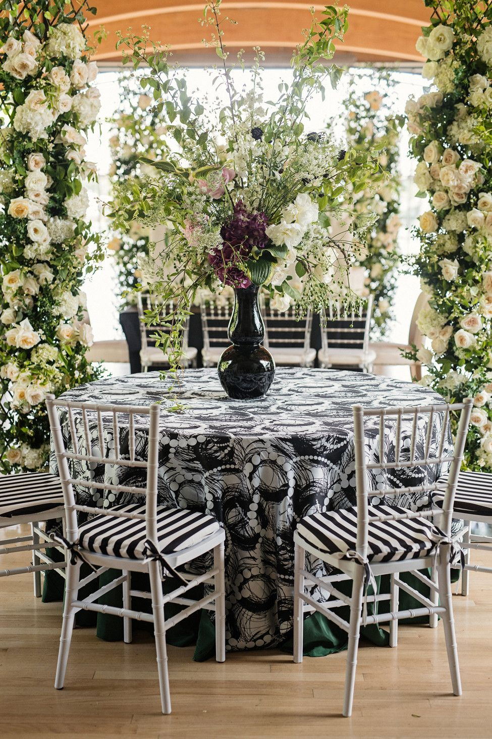Styled Shoot Contemporary Romance Reception Table With Silver Chairs And Large Centerpiec Reception Table Decorations Large Centerpiece Wedding Flower Vase