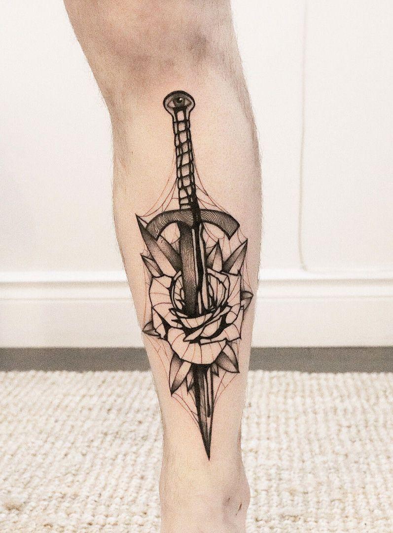 foto de Dagger through rose shin piece by Sewp Twin Oaks Tattoo