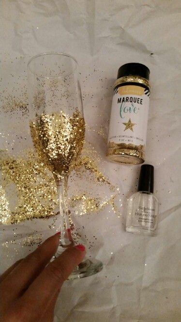 Glitter champagne glasses! #diy #champagneGlass #GoldGlitter #ClearNailPolish #Glitter #Homemade