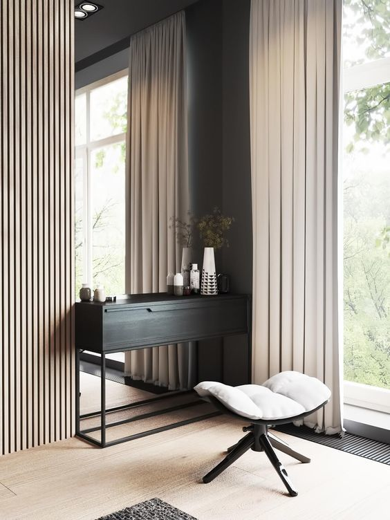 Contemporary vanity space Chic draperies mirror the texture of the