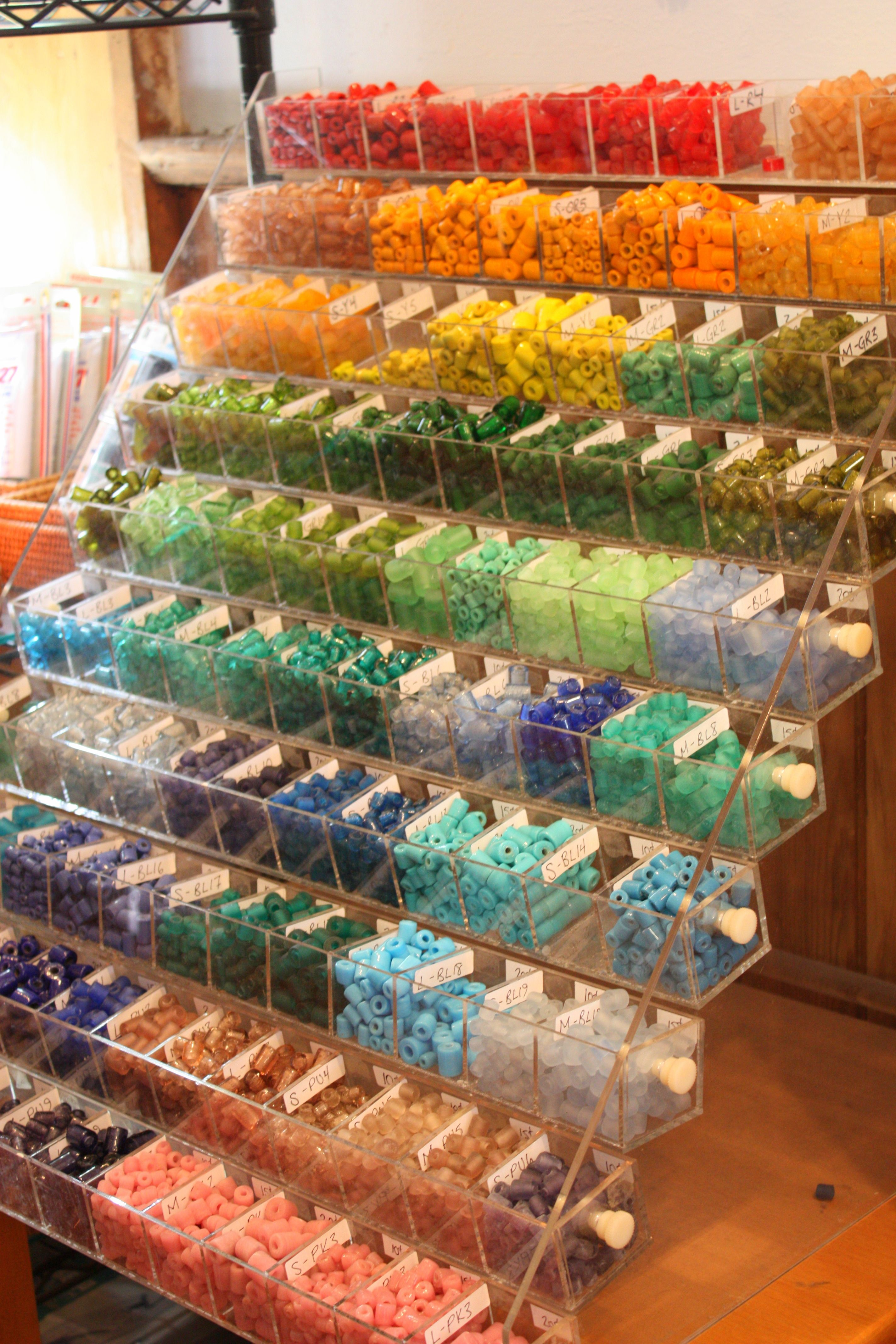 Rainbows of beads, covering our store! Bead storage