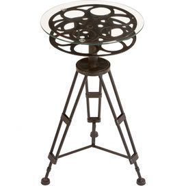 "Glass-top accent table with a metal tripod base and film reel design.  Product: Accent tableConstruction Material: Metal and glassColor: Clear and bronzeDimensions: 25"" H x 15"" Diameter"