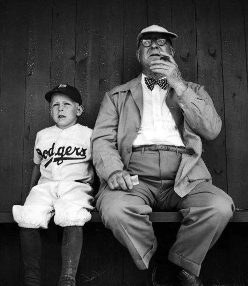 Brooklyn Dodgers general manager Branch Rickey sitting with his grandson while watching spring training. Photograph by George Silk. Vero Beach, Florida, USA, 1948.