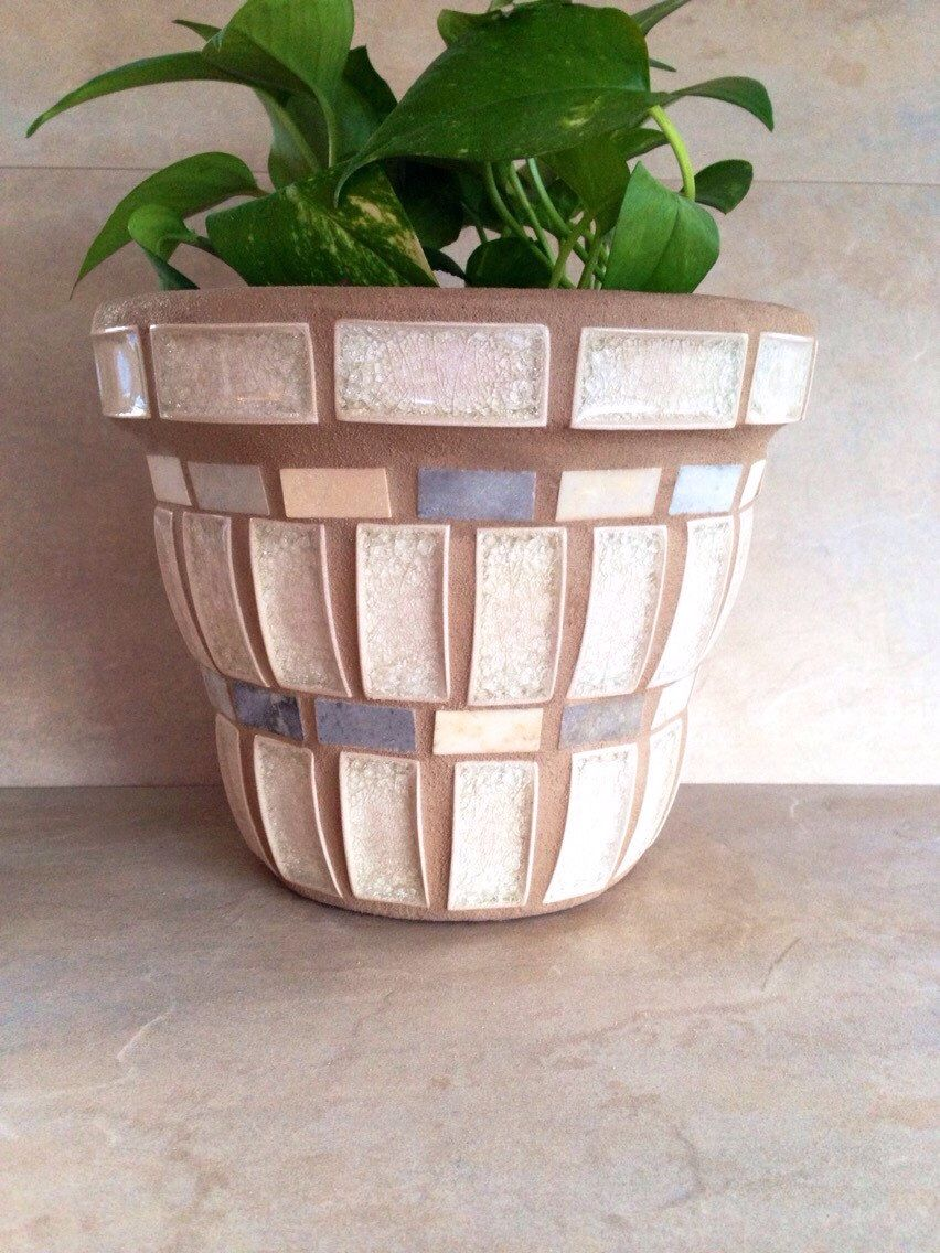 A personal favorite from my etsy shop httpsetsylisting mosaic flower pots planters start off as new clay terracotta pots this handmade pot is made from materials that include tile glass pieces and workwithnaturefo