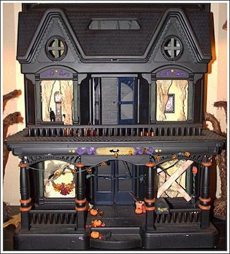 Halloween decorations to make.      This is one of those pink plastic doll houses which has been spray painted and decorated, nice work!