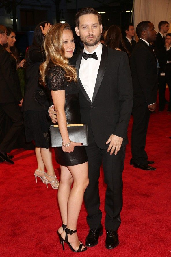 Tobey Maguire (wearing Saint Laurent), cuddles up to his jewellery designer wife