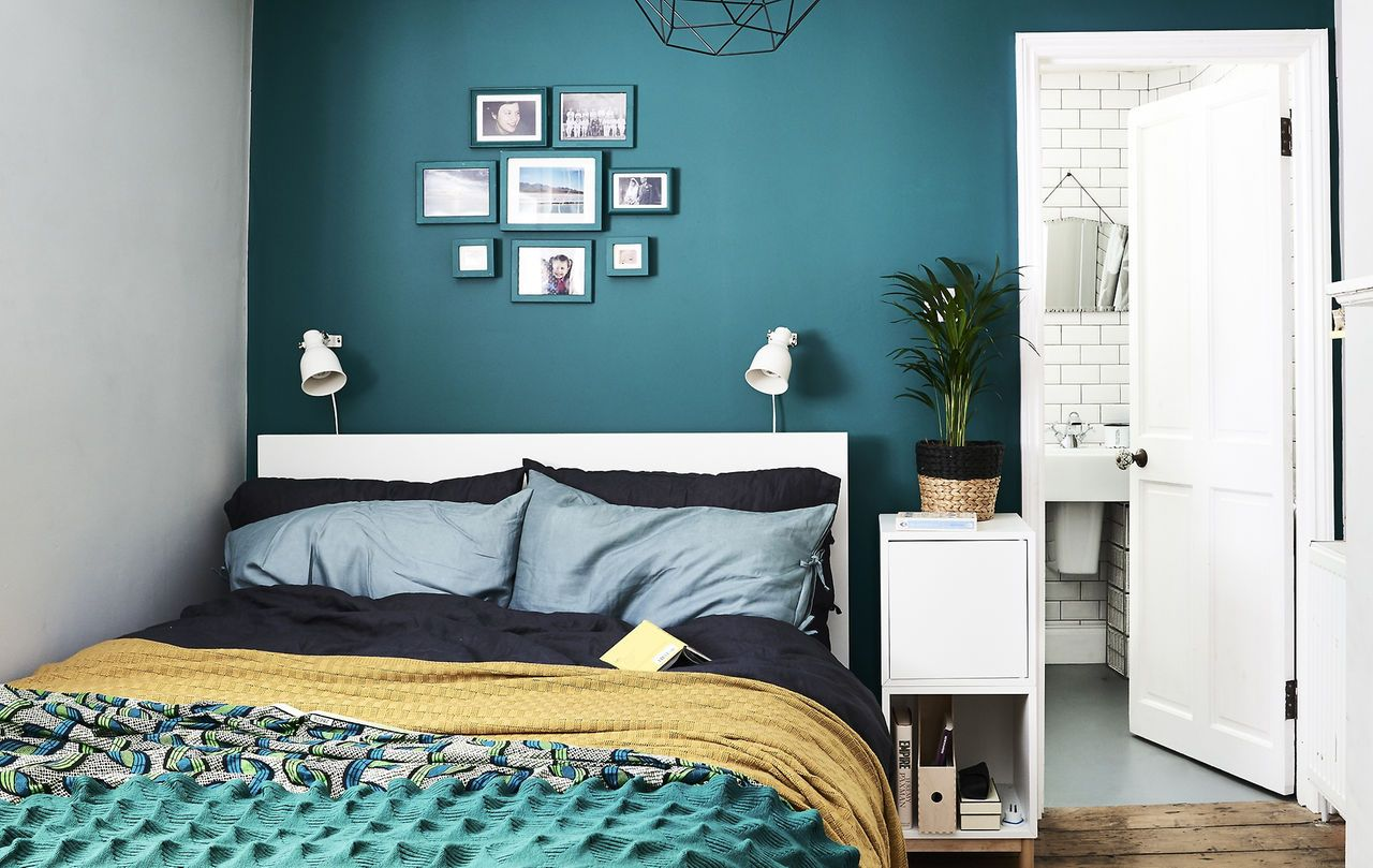 a bedroom with dark green wall and colourful bedding spare rh pinterest com