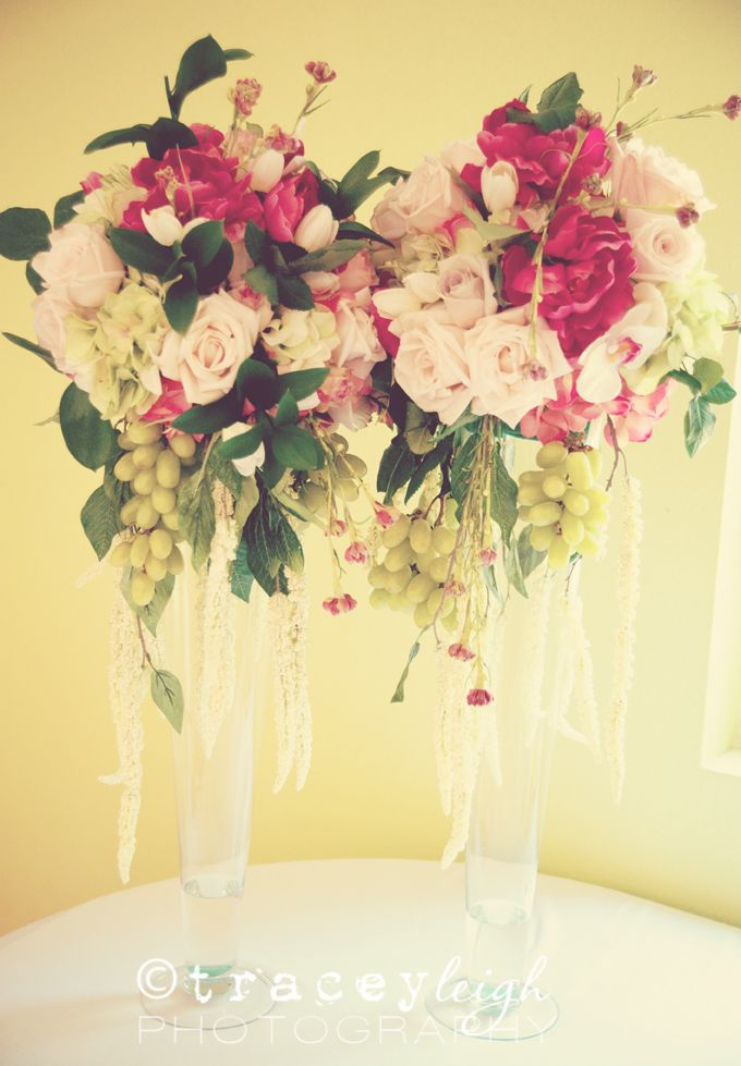 wedding centerpieces fake flowers%0A Real roses and grapes were mixed with silk flowers to keep cost down    floral