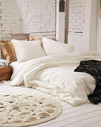 Boho white duvet cover with accent trim creates the foundation for a restful bedroom. #dormdecor #collegelife #firstapartment #bohobedroom #bohodecor