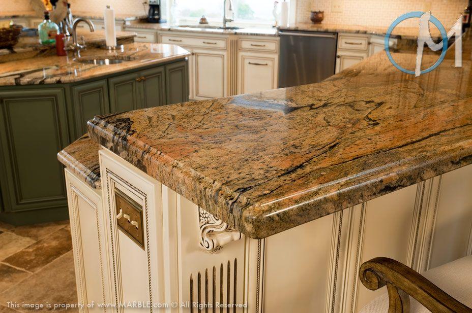 This Dual Level Peninsula Features Peregrine Granite With