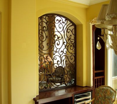 Offers a range of hand-forged wrought iron angle brackets, wall ...