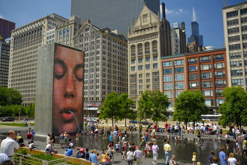 Millennium Park Crown Fountain between the two 50-foot glass block towers that project funky facial videos.