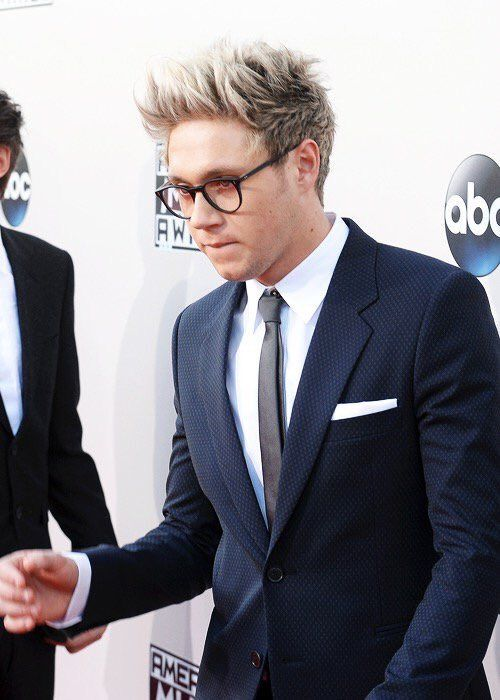 I cannot express how good Niall looks in those glasses and that suit