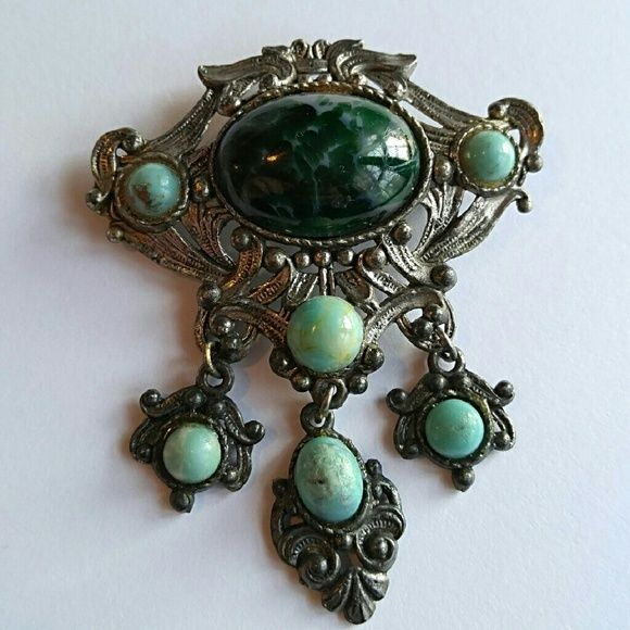 Vintage art glass brooch Victorian Revival This exquisite vintage brooch is made of silver tone metal in Victorian Revival style. In the center is a deep mottled green art glass cabochon surrounded on three sides by mint green cacochons. Three dangling pendants also have mint green glass cabochons.  This brooch is in very nice condition. The only flaw is the cabochon stones on the danging pieces are scuffed up, though this is not terribly noticible. True vintage from about the 1950s From a…