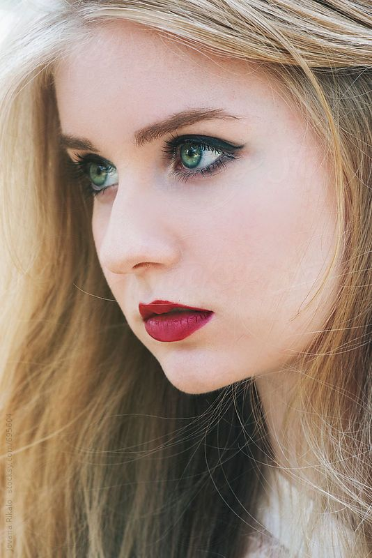 Portrait Of A Beautiful Young Woman With Green Eyes Women With