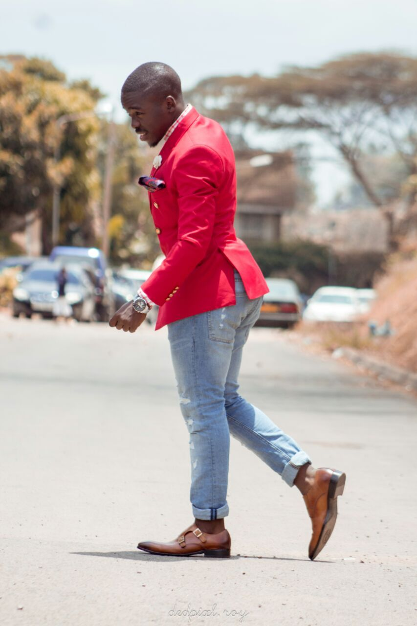 A mixture of red and maroon double breast coat with fitting rugged jeans together matched up with a pair of double monk Daniel Silva genuine leather brown shoes just for that dinner date.
