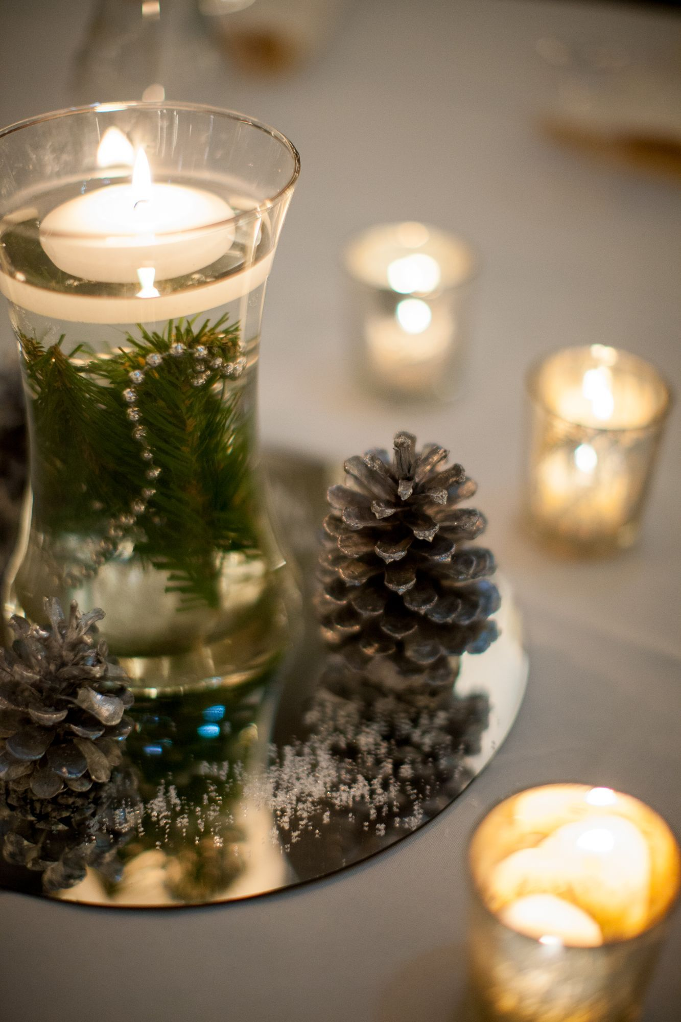 DIY Floating Winter Tea Candle Centerpieces with Pinecones