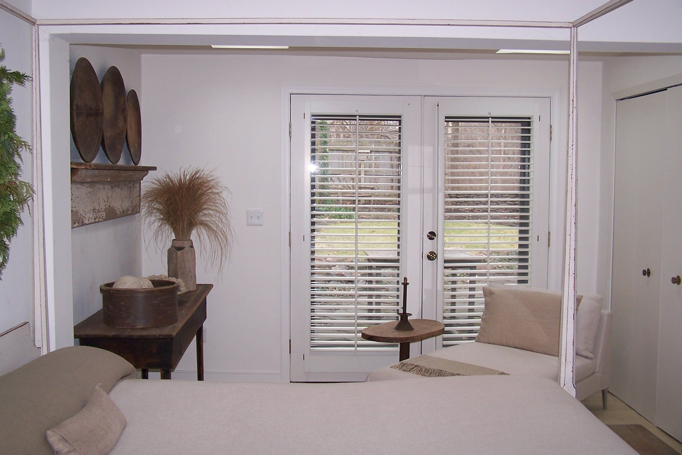 Stunning master bedroom with French doors that lead to the professionally landscaped backyard Ample closet