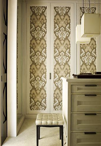 Creative wallpaper application on otherwise boring closet doors.