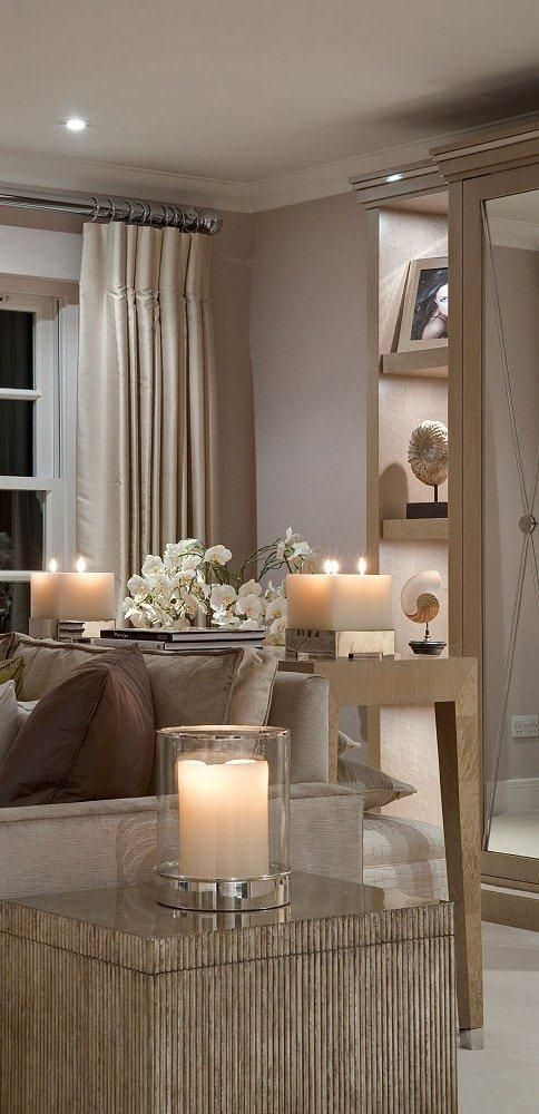 Accent lighting and candlelight complement the rich yet neutral