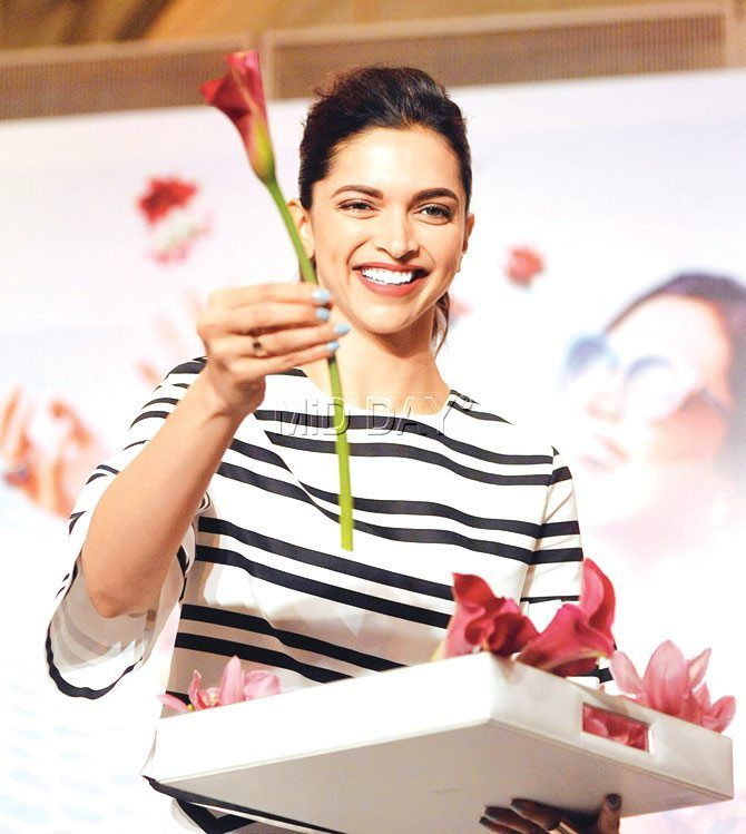 Deepika Padukone plays the flower girl at an endorsement event. #Bollywood #Fashion #Style #Beauty