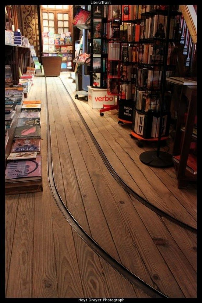 Bookstore with tracks for moving heavy loads of books