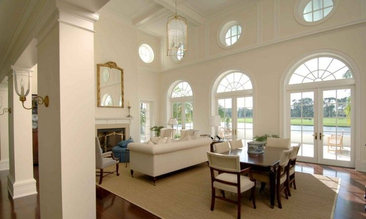 french industrial living room | Ocular (circle) windows and french doors with radius transoms in this ...