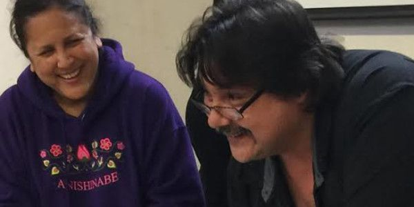 Henvey Inlet First Nation Chief Wayne McQuabbie with Councillor Brenda Contin signing Environment Permit Band Council Resolution  for Henvey Inlet Wind Project.    – Photo by Wanda McQuabbie.