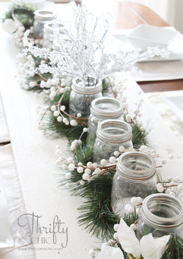 Tablescape idea for Christmas dining table. Wood planks and mason jar tea lights