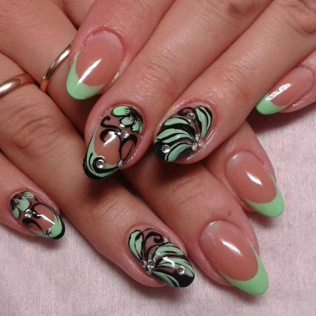 Light green French manicure with nail design and rhinestones ...