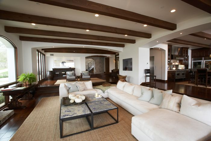 Windsor Smith Home Living Rooms Rustic Exposed Wood Beams White Modern Sectional Sofa Blue Pillows Iron Tables Sisal Rug