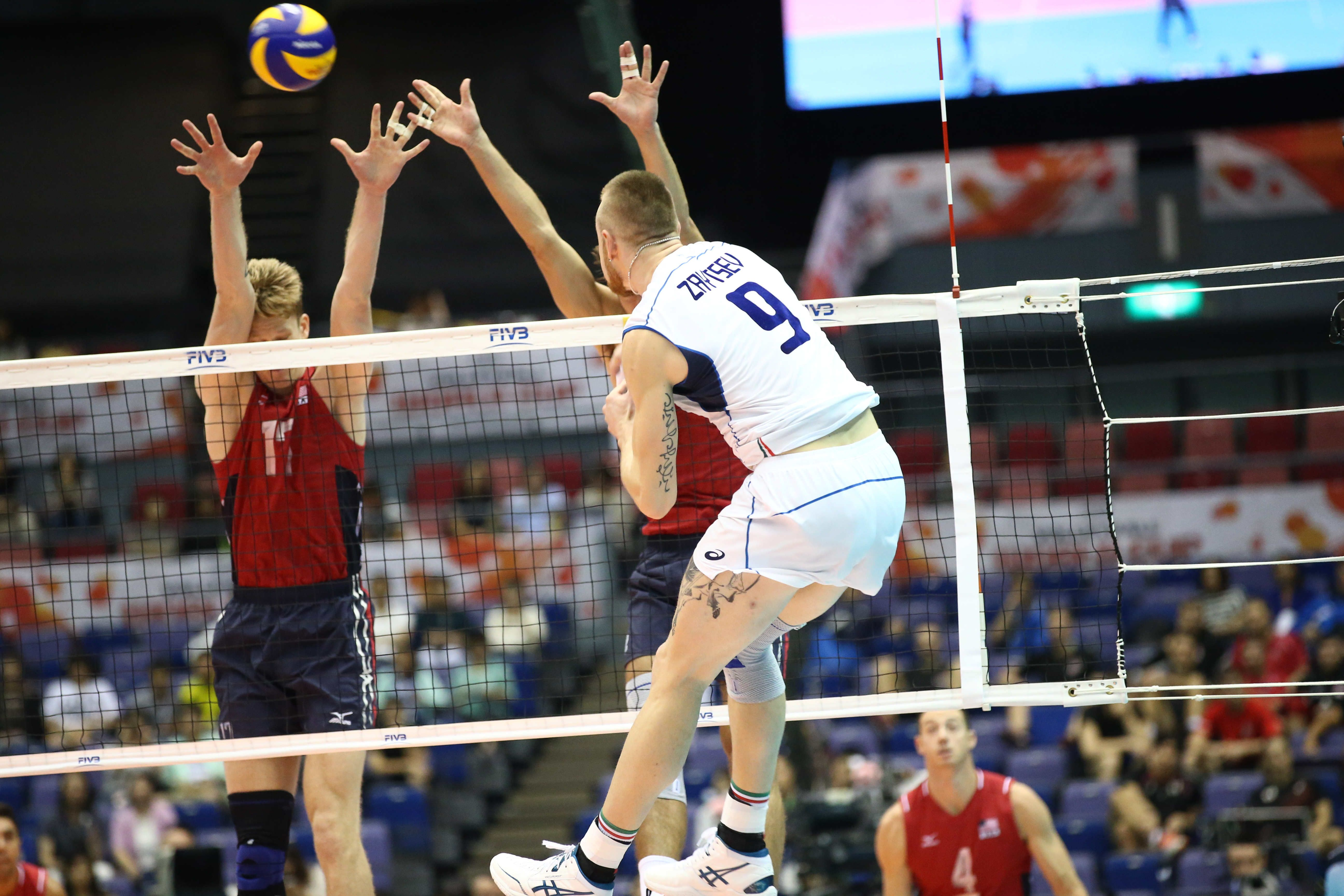 Italy S Ivan Zaytsev Spikes Against Maxwell Holt S Block With Images Mens World Cup