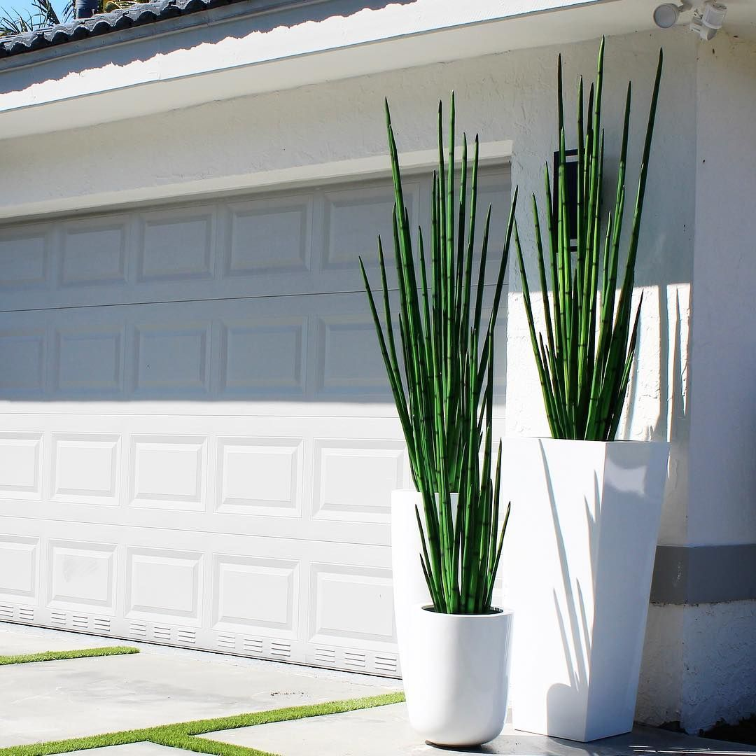 Cfa Design Group On Instagram Artificial Snake Grass And Fiberglass Pots Modern Sleek And Perfect To Make You Snake In The Grass Grass Decor Outdoor Pots