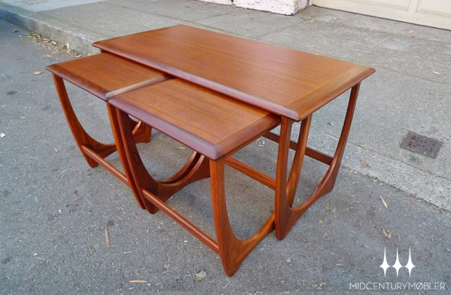 Set of mid century modern long teak nesting designed by Victor Wilkins for G Plan's Astro collection.