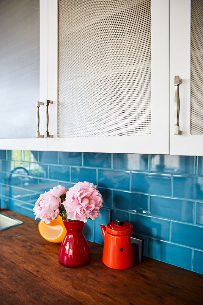 Perforated Metal Cabinet Doors Allow Air To Flow Through But Mostly Hide  The Dishes Inside
