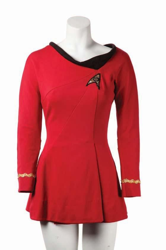 Woman's Starfleet uniform from Star Trek: The Original Series. (NBC-TV, 1966-69) The red polyester minidress (indicating its use in the third season) features a wide black collar, long sleeves with invisible zipper in back, plus Lieutenant braid on cuffs and Starfleet Science insignia. $11,000