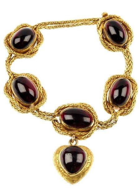 A late 19th century gold garnet bracelet.