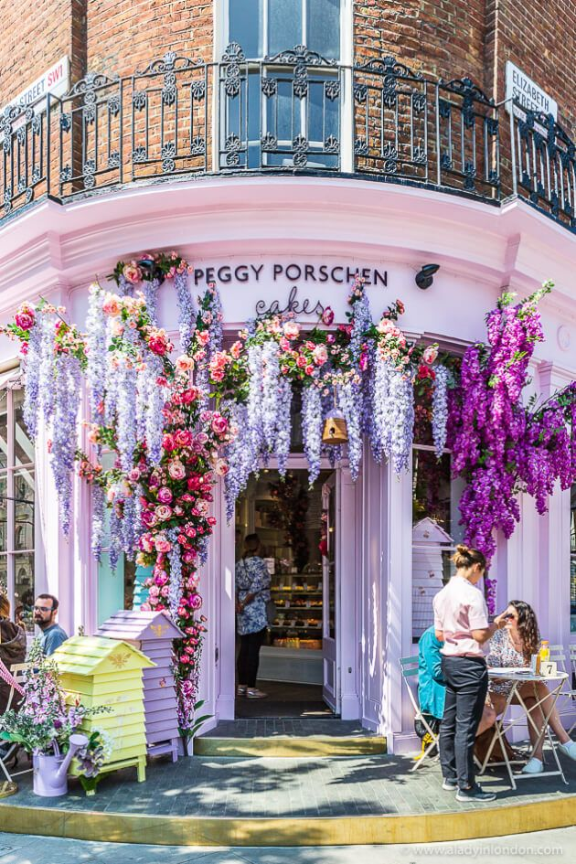 The beautiful Peggy Porschen Cakes shop decorated with flowers for summer in London's Belgravia. #shop #london #belgravia #summer #flowers