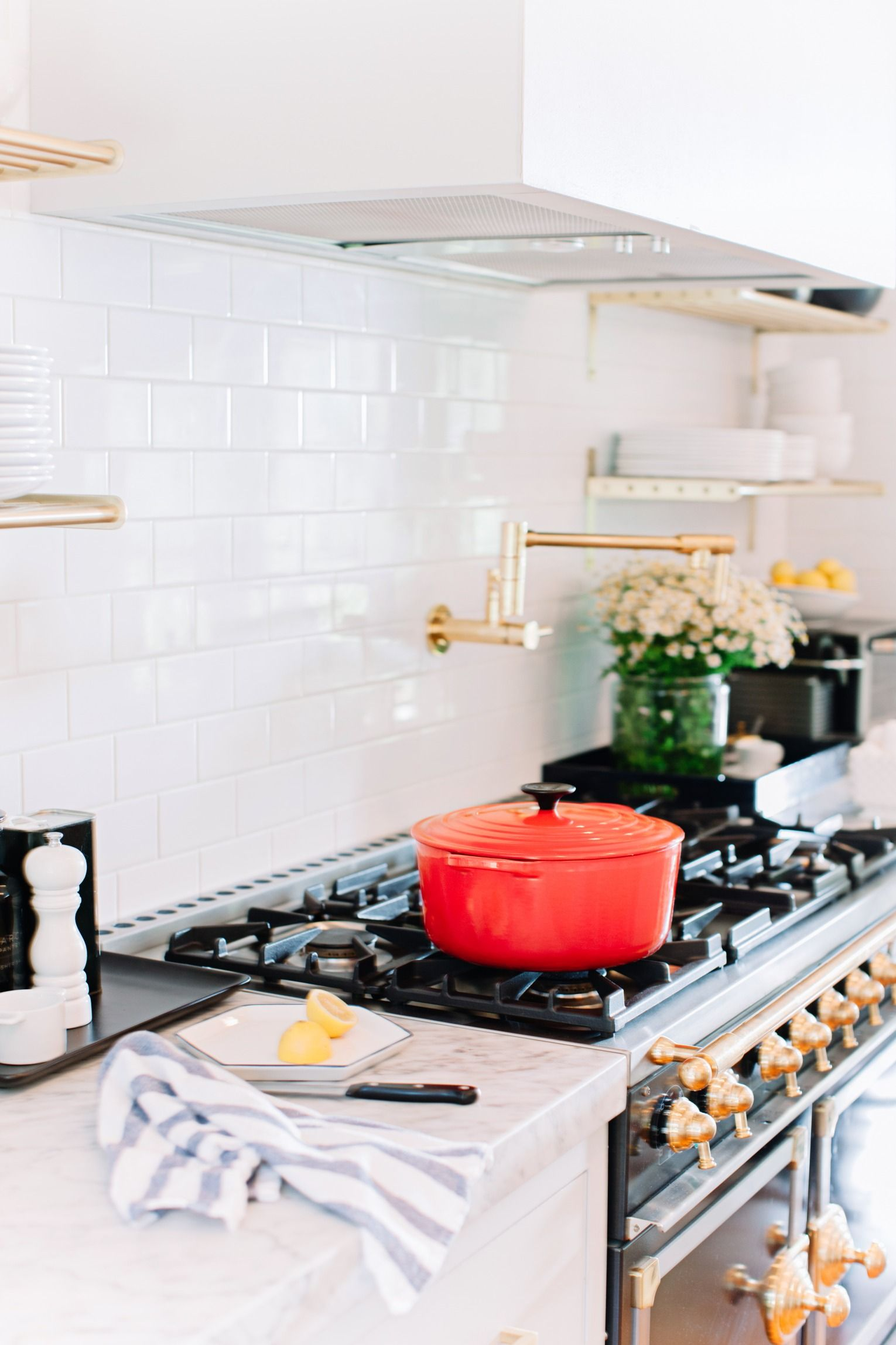 Gorgeous Gleaming Br Kitchen Accents And Red Le Creuset