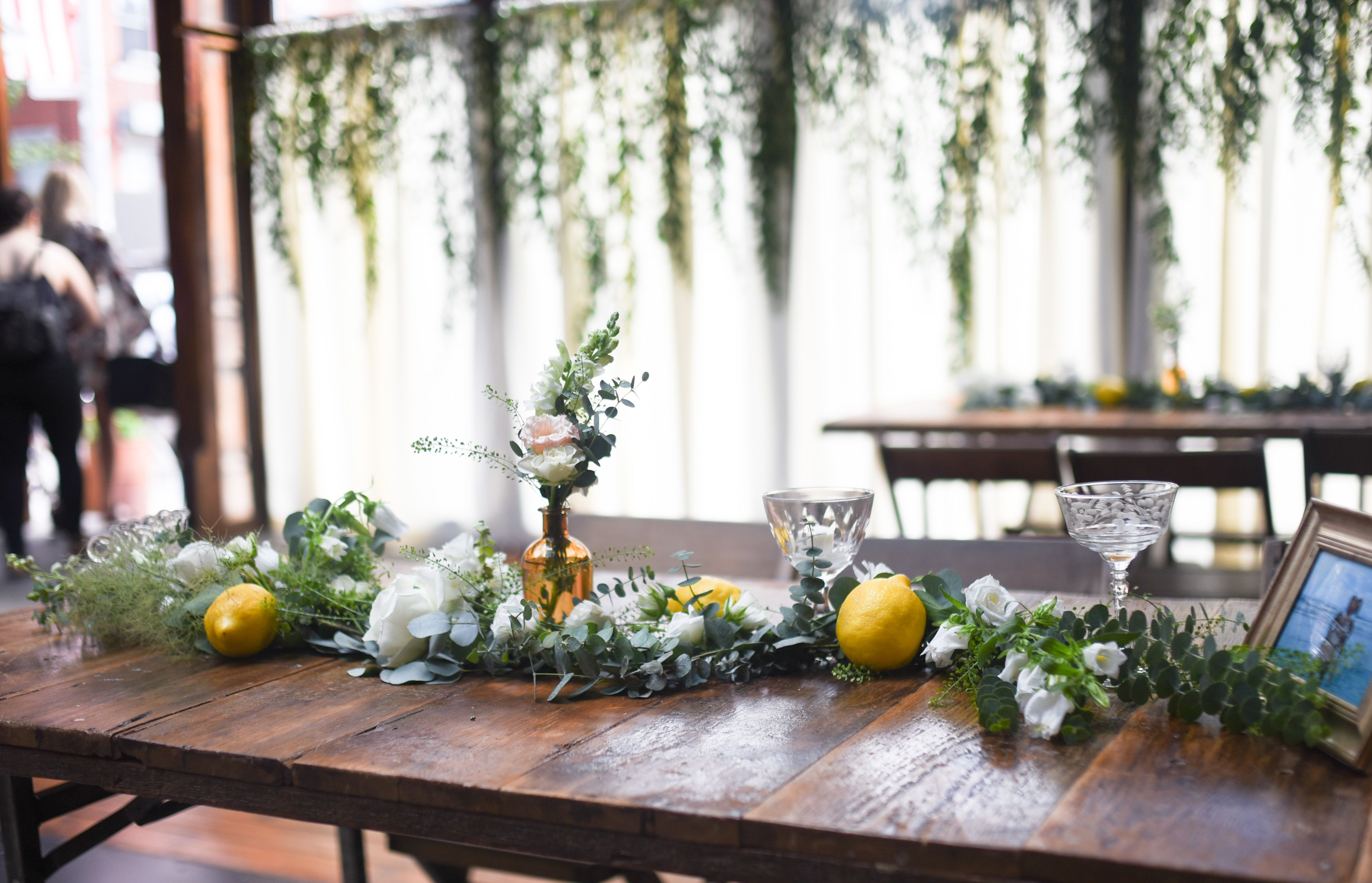irina at brooklyn winery greenery garlands and lemon decorations for bridal shower at brooklyn winery in williamsburg white flowers eucalyptus greenery
