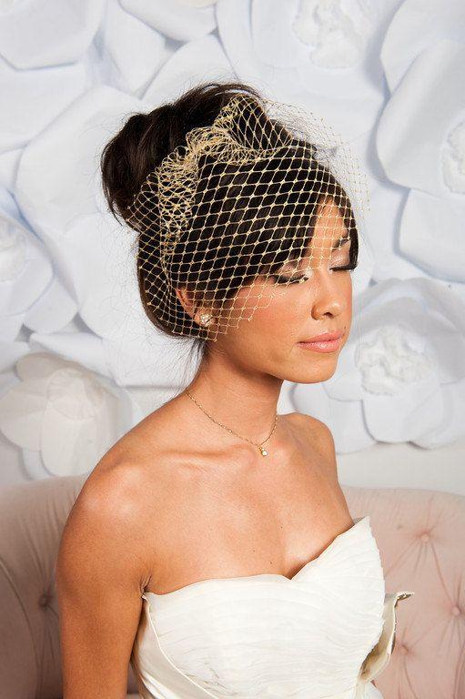 7bd963b022ad2 Garter Girl Loves  This gold birdcage veil