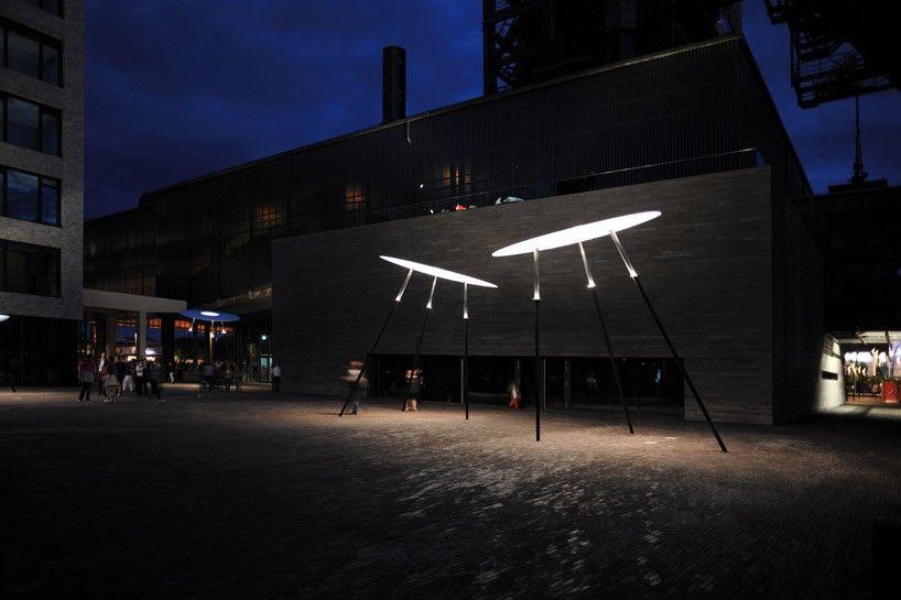 ingo maurer's guddevol street lights create an intimate setting in luxembourg
