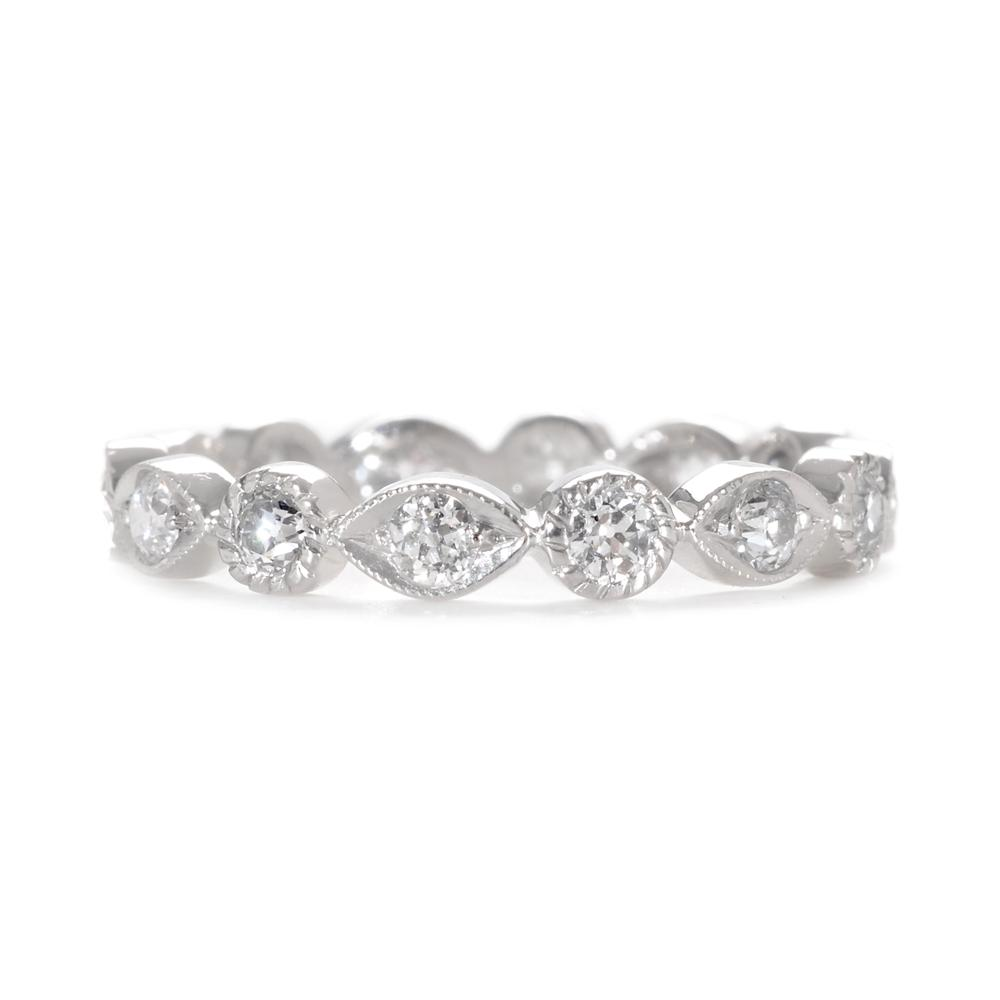 vintage wedding band This decorative diamond wedding band features alternating marquis shapes and circles dotted with brilliant pave diamonds
