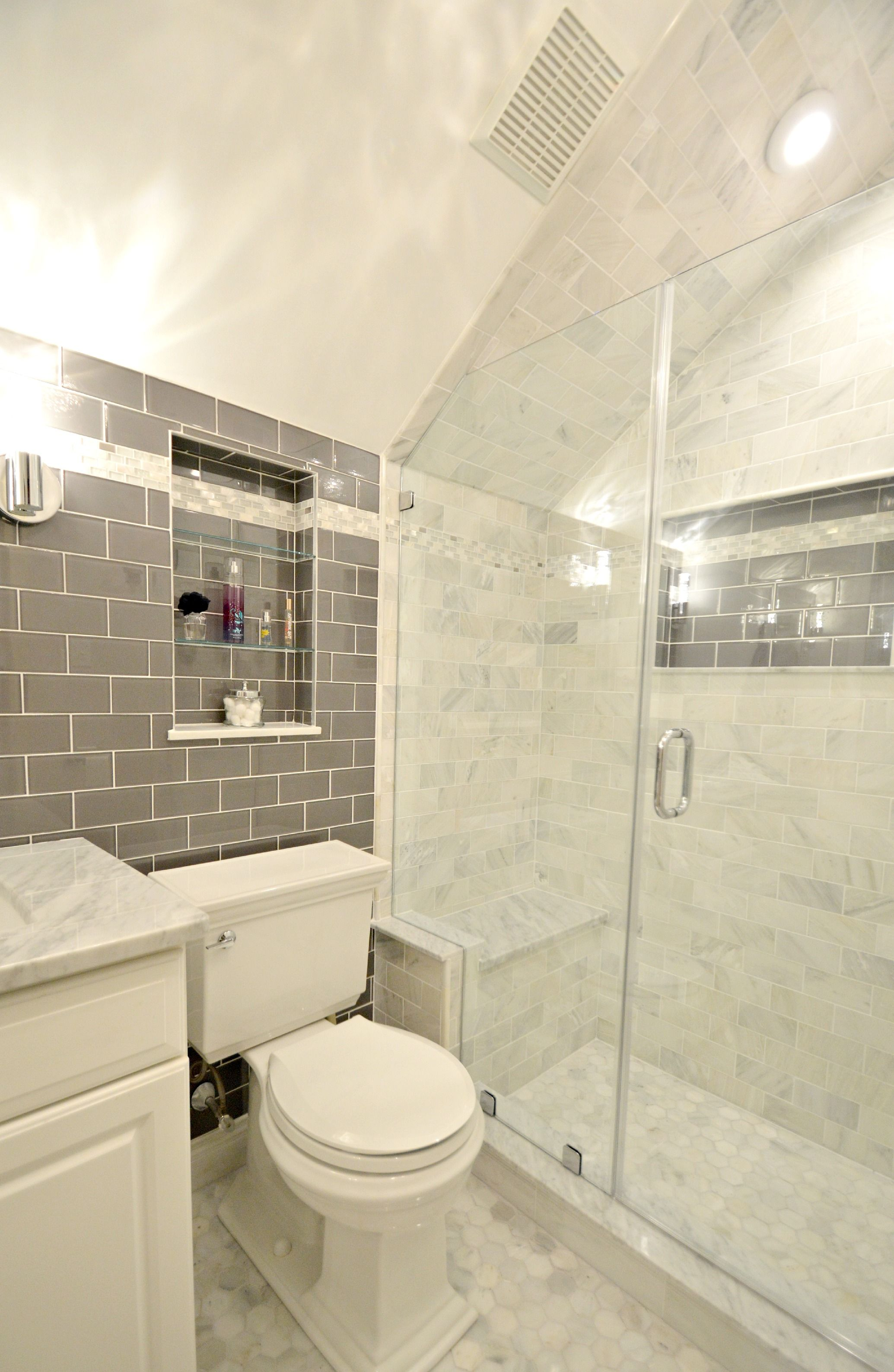 bathroom remodel features glass tile wall and carrara 24404