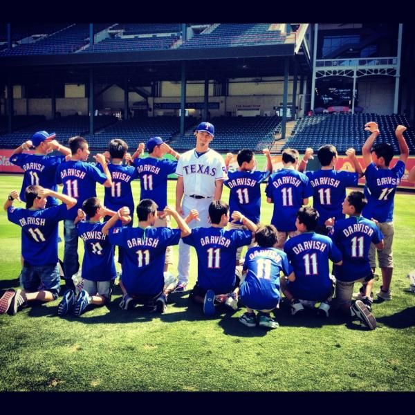 Yu Darvish with a Japanese little league team from an area affected by the Tsunami.