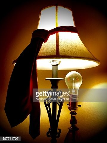 Stock Photo Close Up Of Necktie On Illuminated Electric Lamp Electric Lamp Lamp Novelty Lamp