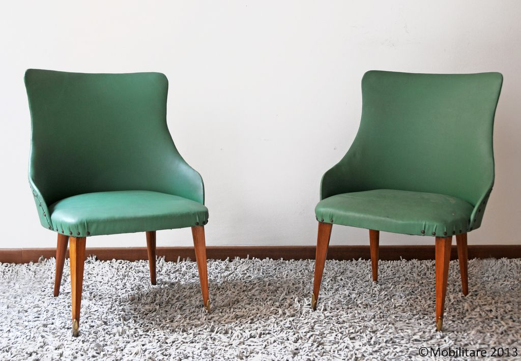 Mobilitare - A pair of armchairs with the original green leatherette upholstery and brass detailing on the front legs.